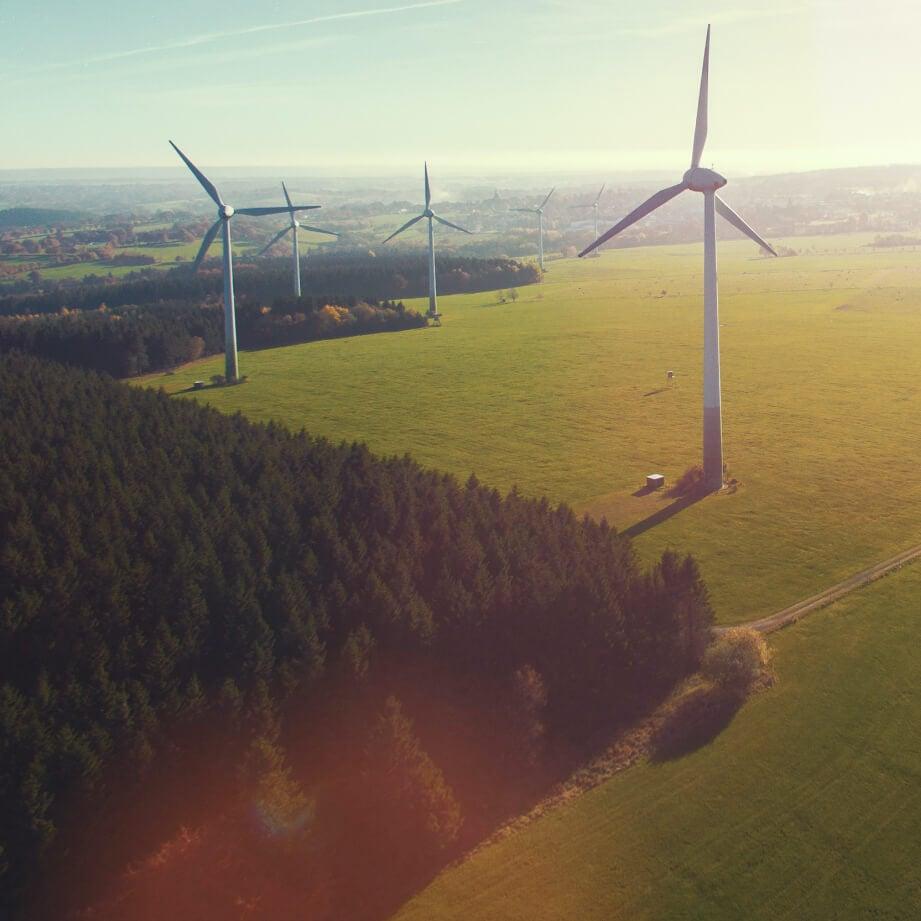 Aerial shot of wind turbines at dusk